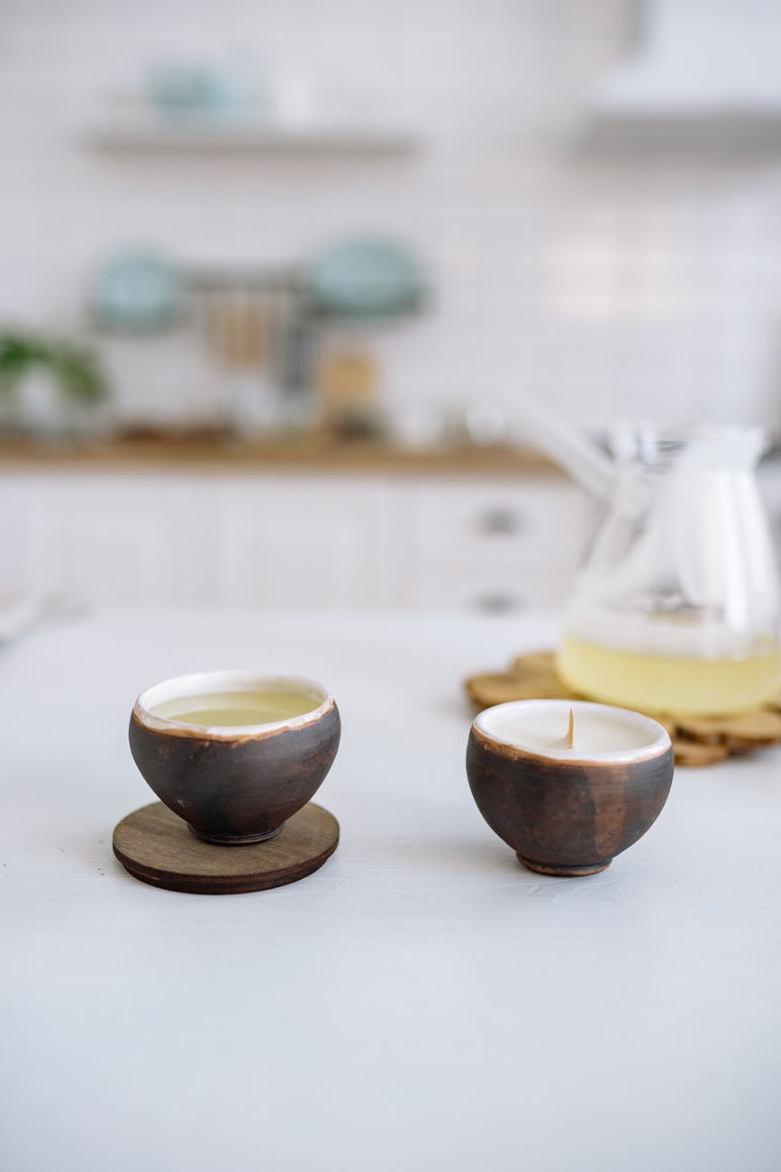 candles in small brown cups