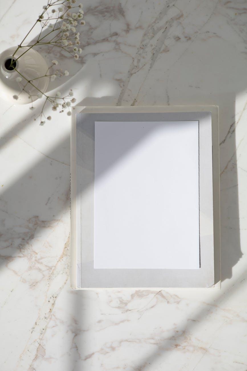 white wooden frame on white ceramic tiles